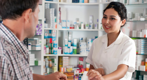 Pharmacist giving medication to a customer